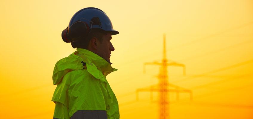 Transmission worker at sunset